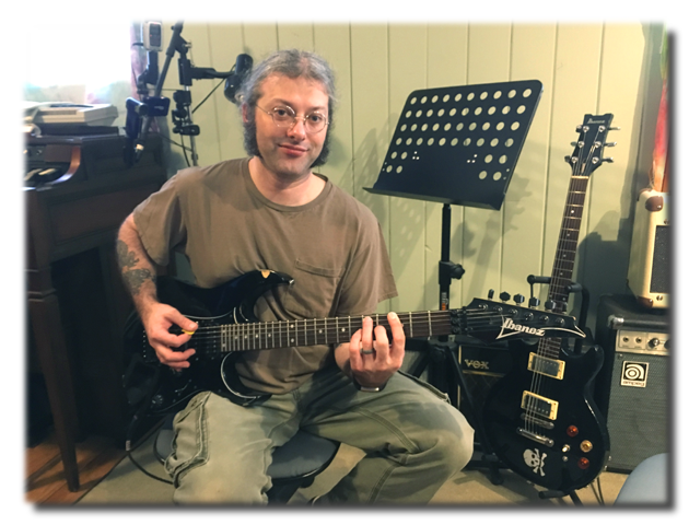 Stephen in the lessons studio, with his Ibanez guitars